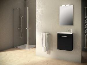 Mueble negro para colgar en pared con tirador metálico con lavabo blanco.